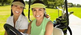 two women golfers in a cart